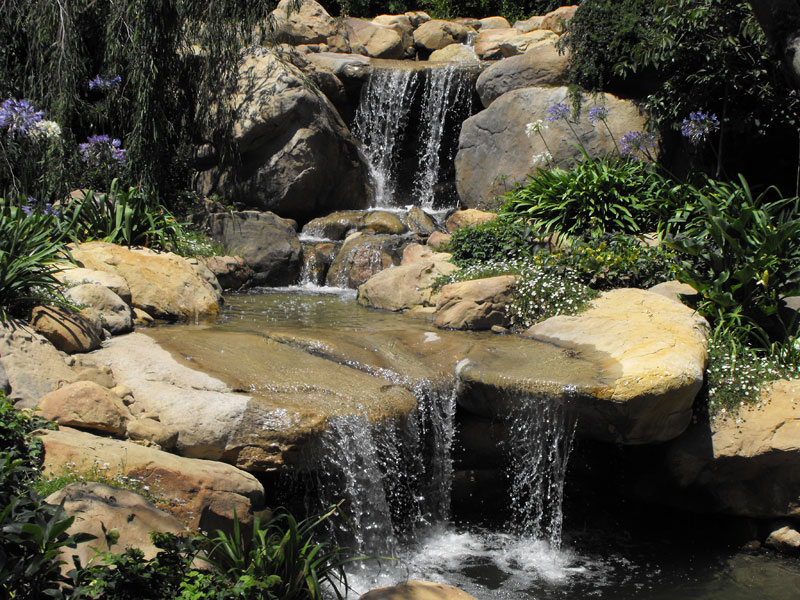 Waterfalls Into A Koi Pond Garcia Rock And Water Design Blog