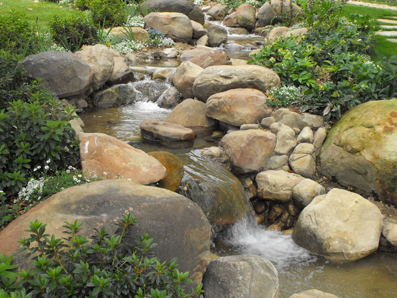 Building a creek garcia rock and water design blog for Rock ponds designs