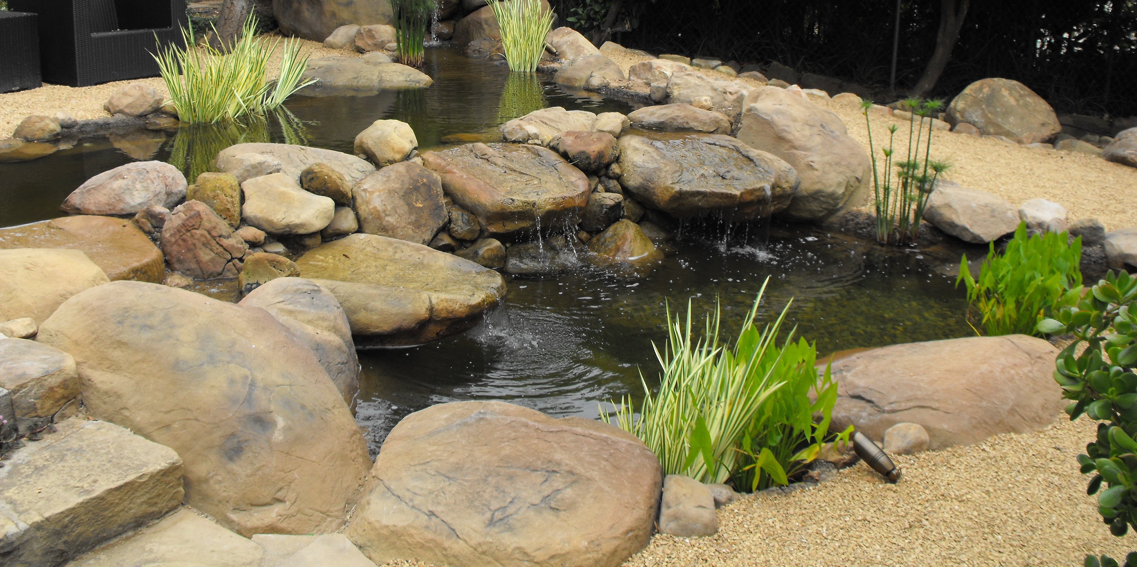 Projects garcia rock and water design blog for Fish pond waterfall ideas