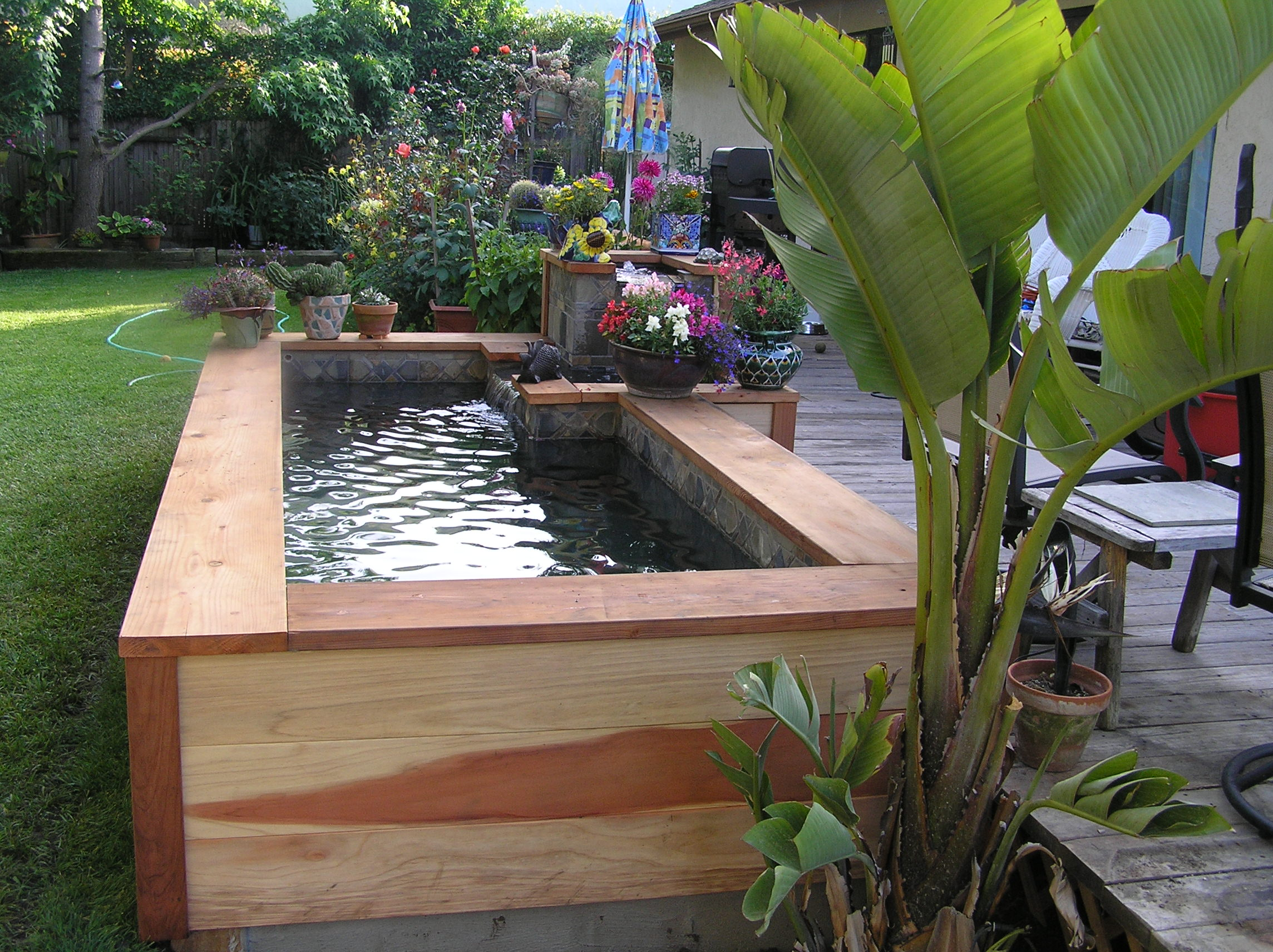 Small garden ponds in santa barbara garcia rock and for Wooden koi pond construction