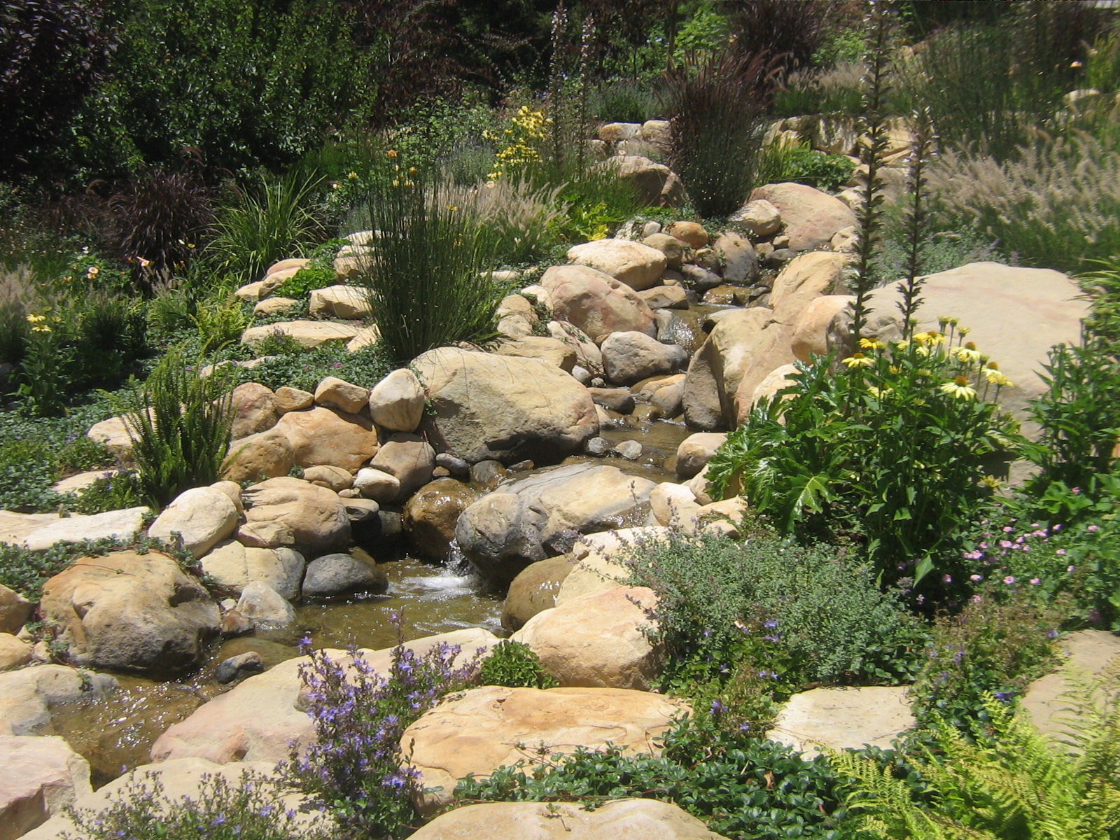 Santa Barbara Sandstone Rock, Boulder And Cobble Incorporated Into This Man  Made Water Feature.